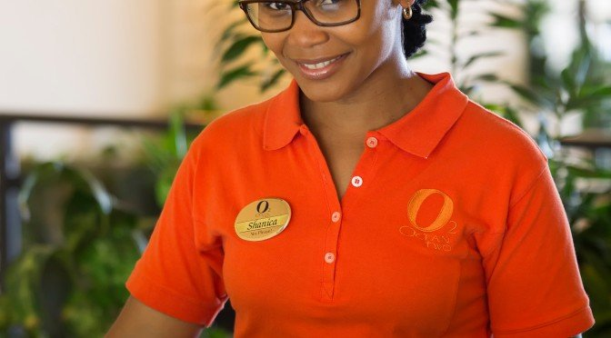 A happy front desk clerk at Ocean Two in Barbados
