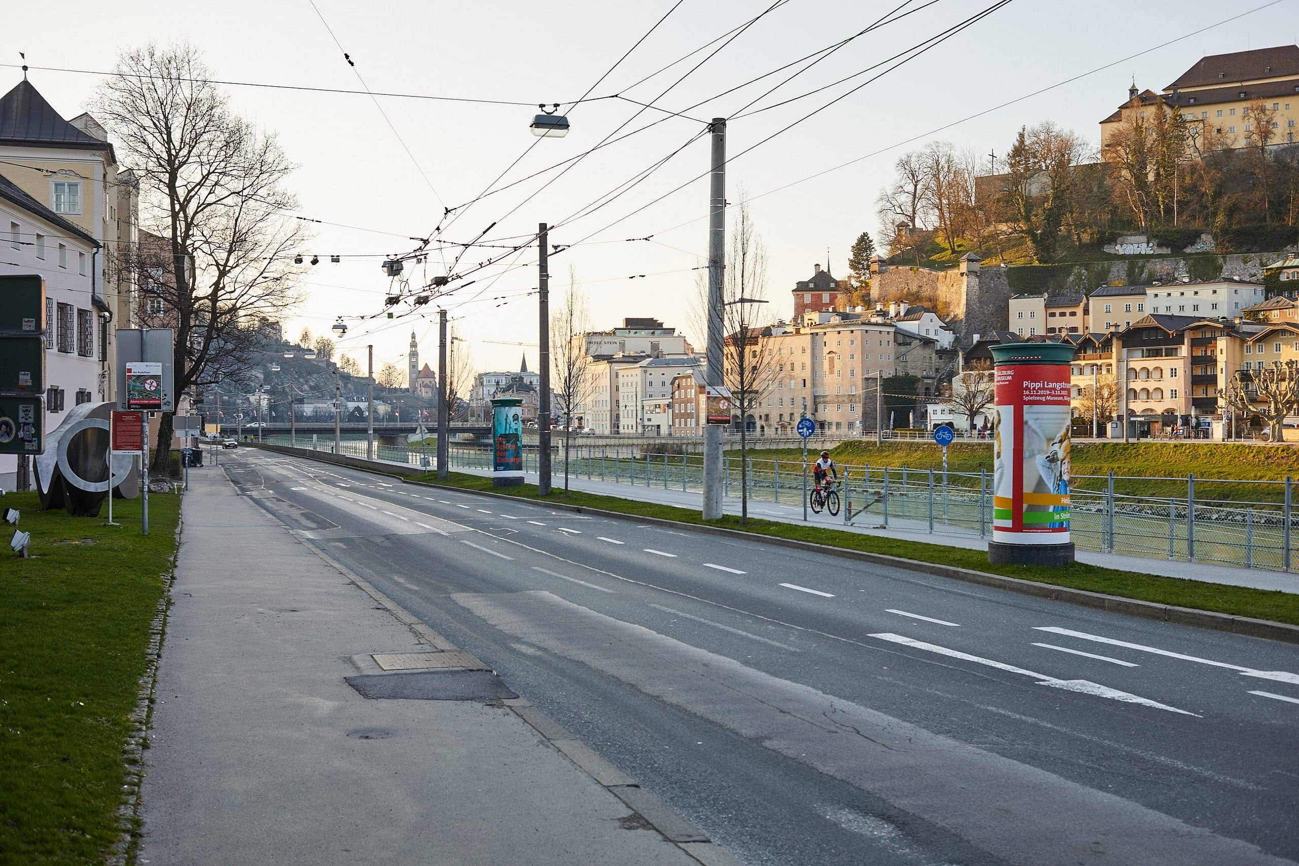 A photograph showing the empty Streets of Salzburg, Rudolfskai
