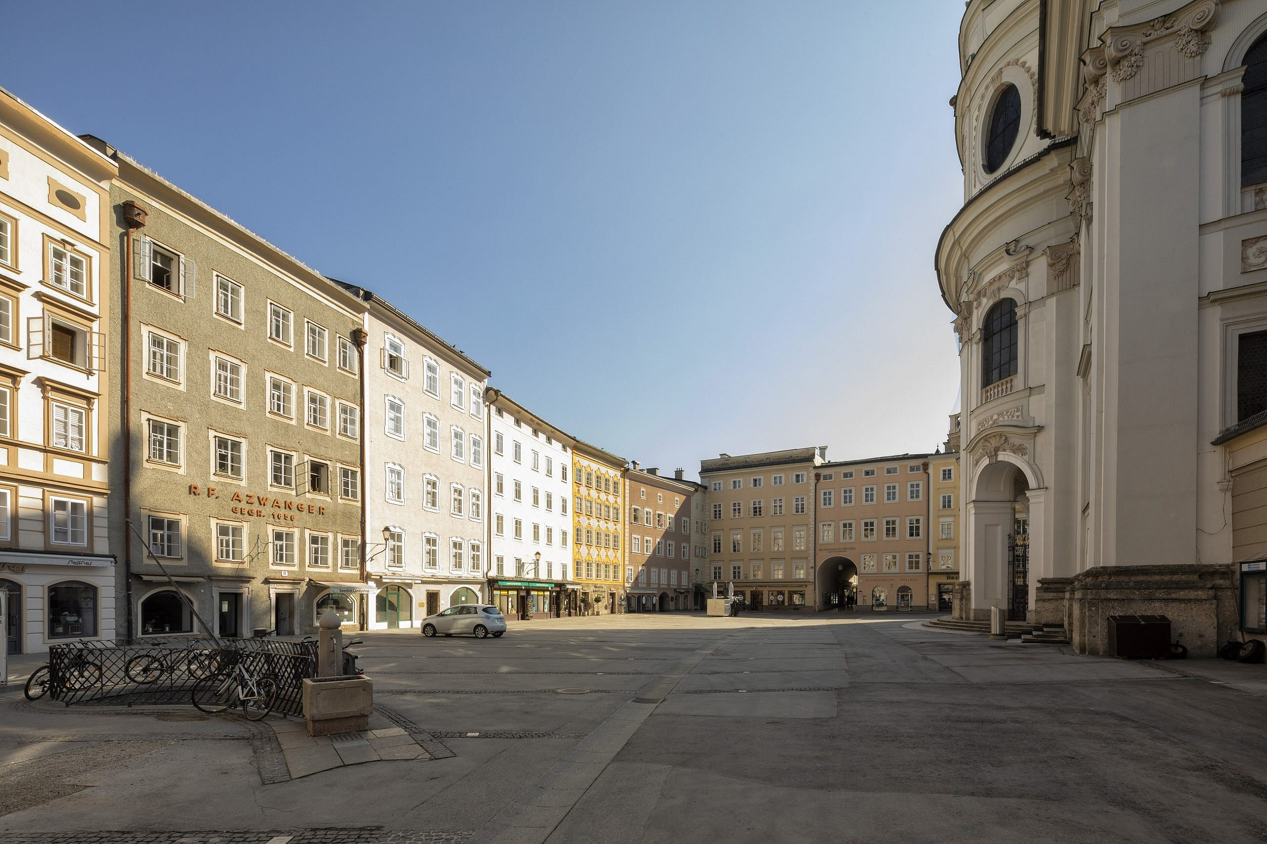 Photograph of an empty Universitätplatz Salzburg