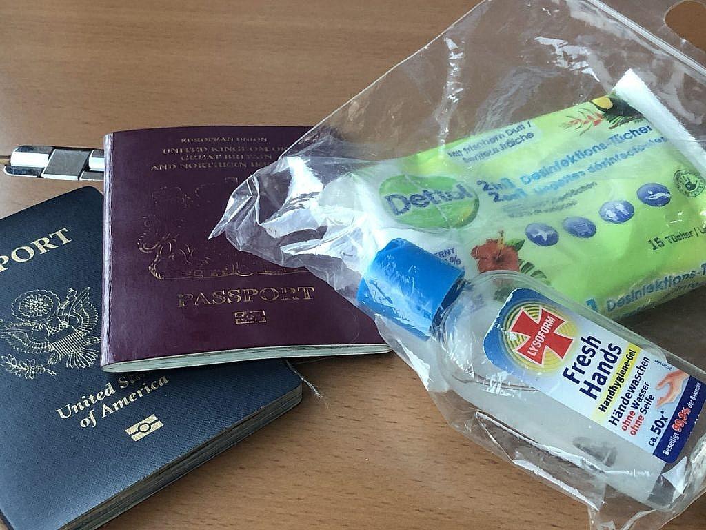 British Passport, USA passport, Hand sanitizer and anti-bacterial wipes